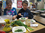 Lothrop students making kale salad.