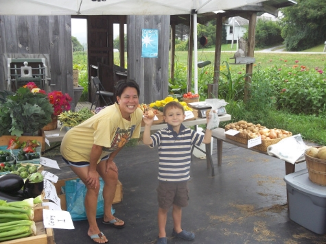 Erin and Miles Robbason picking up their farm share at Radical Roots Farm in Rutland. Carol Tashie/photo