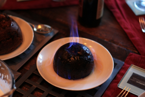 Figgy pudding served alight at a holiday celebration.