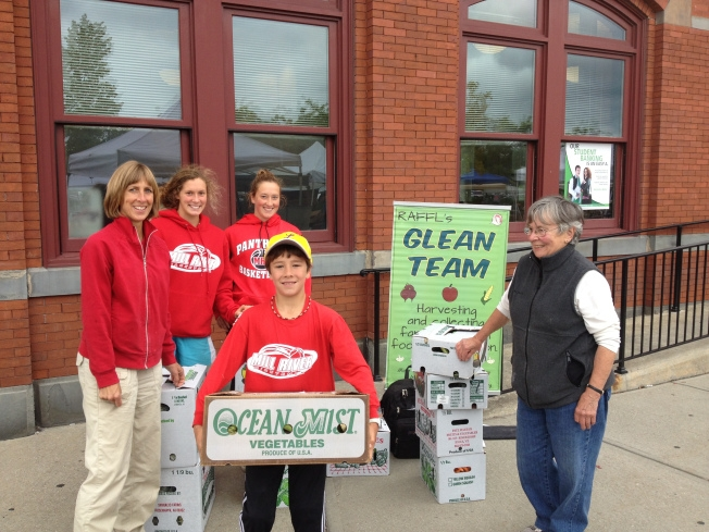 Volunteers at the Rutland Farmers market this past summer pack boxes of fresh produce for donation. Sam Dixon/ photo