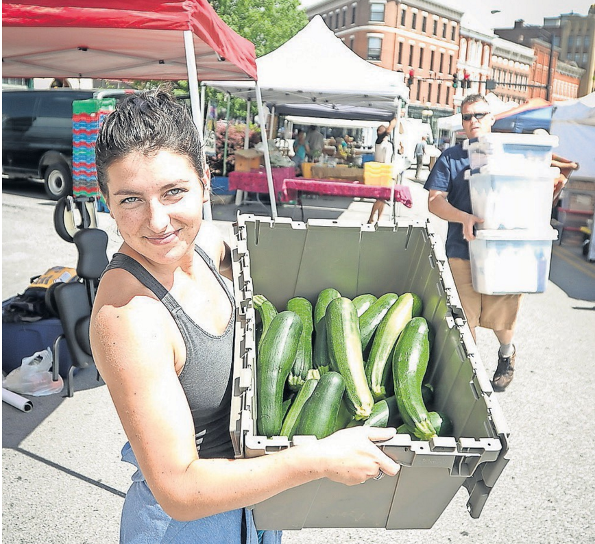 "Mary Bilecki carts off some zucchini at the Rutland Farmers Market. She serves as the glean team coordinator at Rutland Area Farm and Food Link through the AmeriCorps VISTA (Volunteers In Service to America) program. Last year the glean team was able to collect more than 29,000 pounds of produce from 24 farms and homesteads. The produce was given to 28 distribution sites in the Rutland region. ""I believe everyone, no matter the walk of life, deserves access to healthy, locally grown produce,"" Bilecki said."