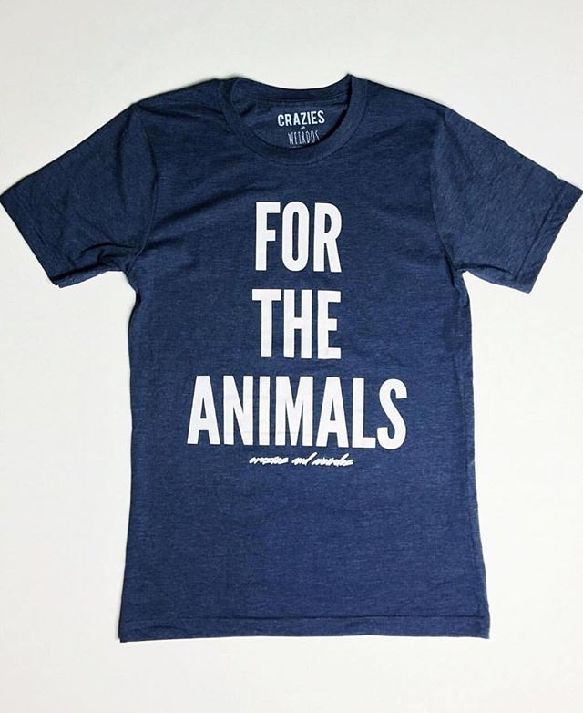 "Handmade in New York from recycled plastic bottles and organic cotton, our vegan #ForTheAnimals ""Loyal"" blue shirt is now back in stock in both women and men's cut.  These are limited edition only.  Shop now by clicking on the link in our bio or by going to craziesandweirdos.com before they are all sold out.  A portion of sales will be donated to nonprofits fighting for animal rights.  #craziesandweirdos"