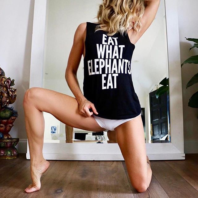 She is beautiful, strong and truely about that yogi life.  Vegan as fuck for the win!  Thanks @bananablondie108 for making us look good! 😍🐘🌿💁🏼 _____________________________________________________________ Handmade in New York from organic bamboo and cotton, our comfy black #eatwhatelephantseat tanks are now back in stock.  Perfect for yoga, running or just styling.  Shop now by clicking on the link in our bio or by logging on to craziesandweirdos.com.  A portion of sales will be donated to nonprofits fighting against poaching of elephants.