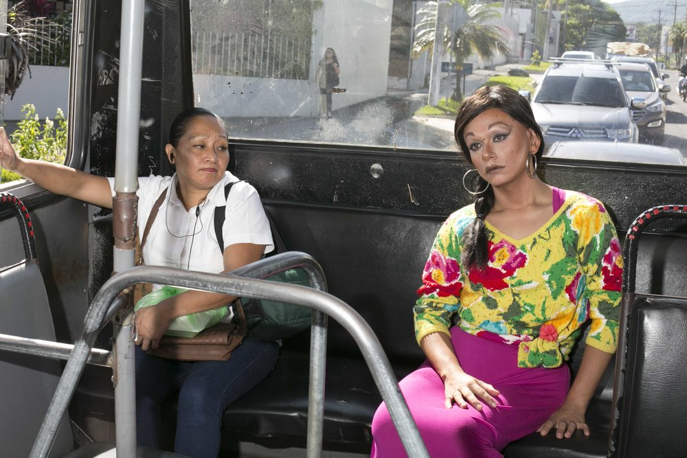 """Riding the bus in drag is extremely dangerous for NadiA but it's her only means of transportation. """"One time I was in the bus (dressed as a male)and that man feel so threatened from my pink socks he show me his knife. He wasn't even bad guy, he just scared,"""" Nadia said. El Salvador has suffered an increase in violence against members of the LGBTQIA community, especially those who are transgenders or transsexuals."""