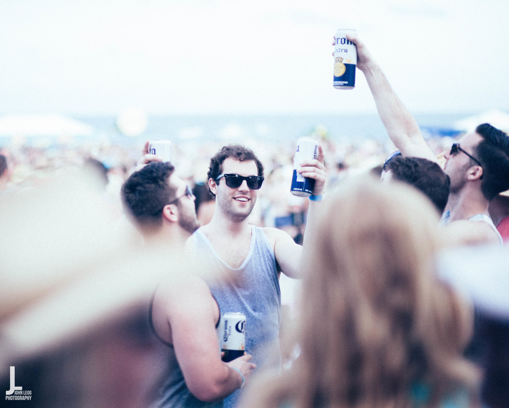 A fan drinking a cold Corona, which happened to be one of many sponsors at this years Tortuga Music festival.