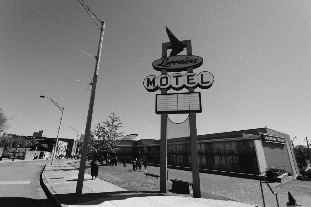 A larger view of the Lorraine Motel sign, with the building in the background.