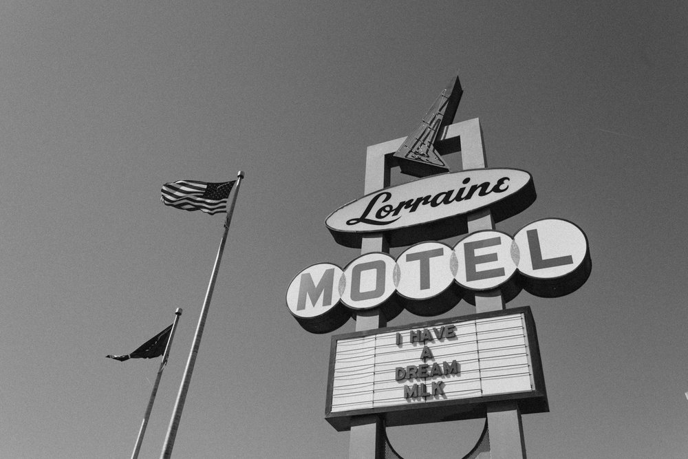 An American flag flies next to the Lorraine Motel sign in Memphis.