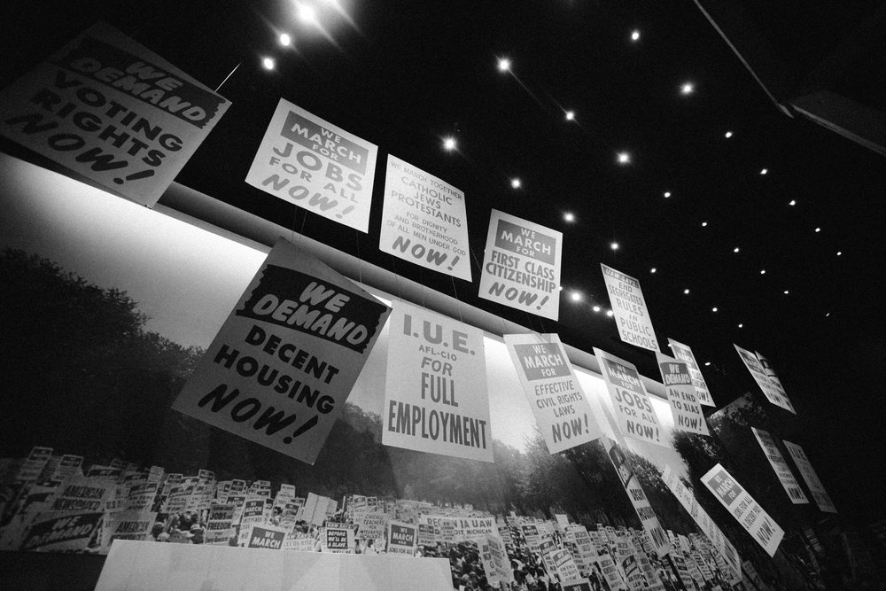 A broad display of protest signs from the Civil Rights Movement.