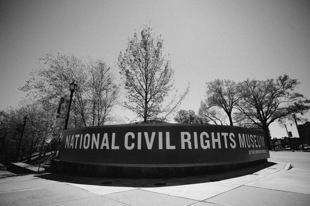 The National Civil Rights Museum sign outside the boarding house building.
