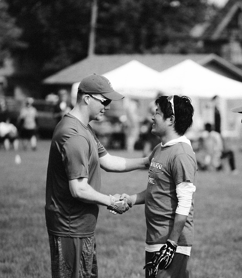 At a GUTS Frisbee tournament in Calumet, Michigan, my friend Brian shakes the hand of a Japanese player that travelled thousands of miles to participate in the tournament.