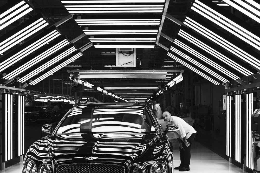 Massimo Uberti in the vehicle audit bays at Bentley's Crewe factory, photographed by Luc Coiffait
