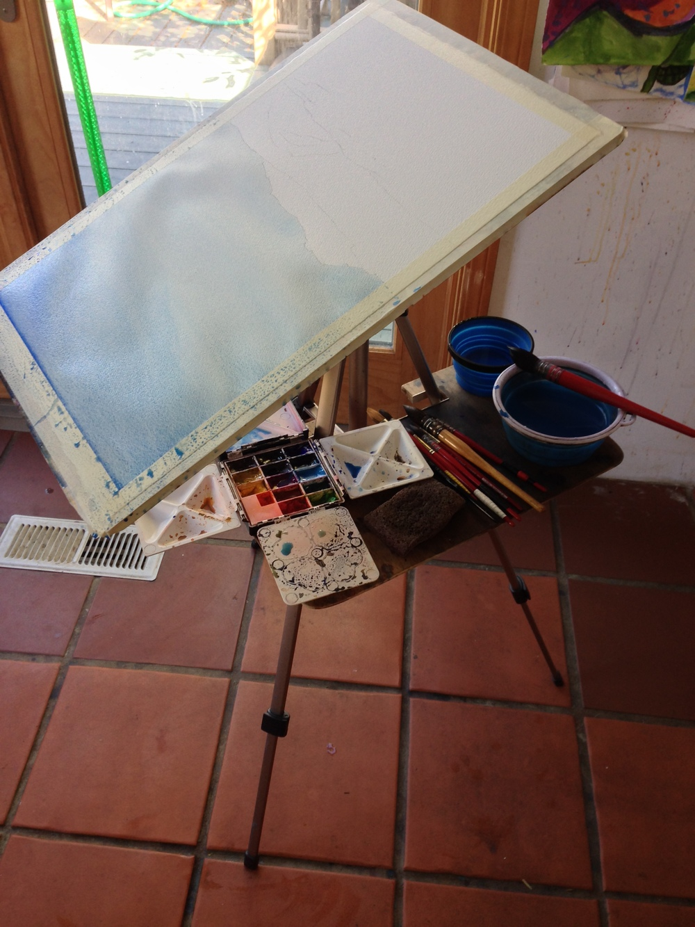"Here I'm painting the sky ""upside Down"", to get it lighter at the horizon and stop any drips from happening."