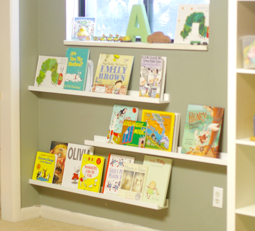 But the 6th place was added a few weeks ago when we purchased these picture  frame shelves from IKEA and made a display book case.