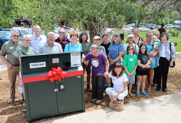 Town Trustees Ron Norris and Wendy Koenig join members of the Bear Education Task Force and League of Women Voters in dedicating a bear-resistant trash and recycling bin in Bond Park.  The new bin was donated by the League of Women Voters of Estes Park in the summer of 2014.  (Town of Estes Park photo)