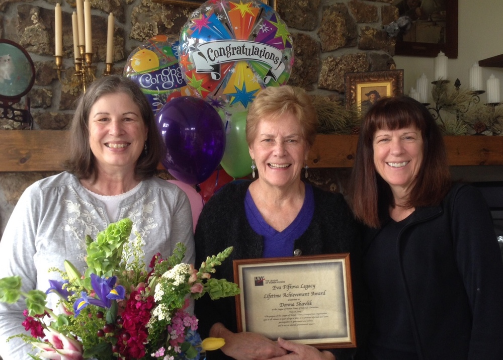 L-R, incoming LWVEP president Bonnie Seals, Donna Shavlik, and outgoing president Jean McGuire after chapter members surprised Donna at home with flowers, balloons, and news of her award. (LWVEP photo)