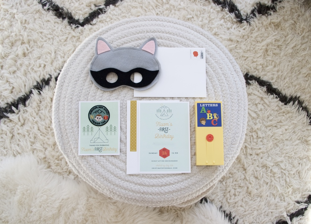Raccoon mask:  Mahalo , Custom badge made by my sister-in-law, Address Label and Postage:  Minted , Invitation:  Black Lab Studio , Video cartridge:  Fisher-Price Classics