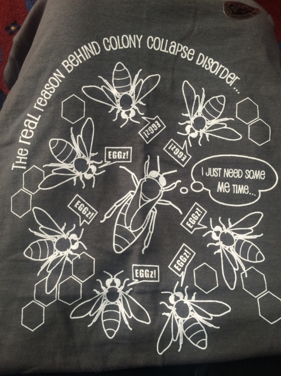 Photo of a t-shirt purchased from the University of Florida Entomology Graduate Student Organization. In honeybees, the Queen is the only member of the colony that produces eggs, while the workers either care for the young or provide food. Photo credit: Rachel Olsson.