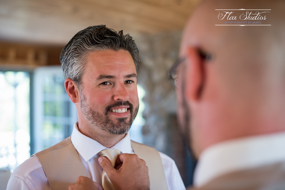 Groom getting his tie fixed