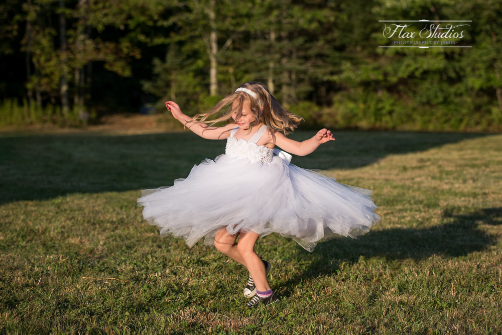 Flower Girl Spinning In Her Dress