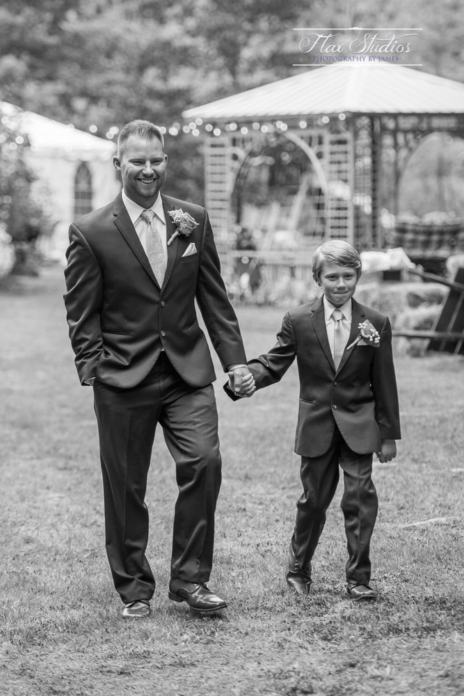 Father walking his son down the aisle
