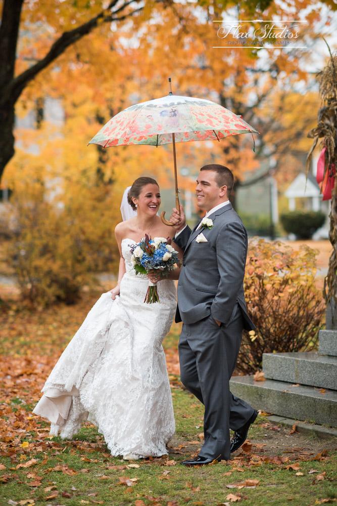 Newlyweds walking in the rain