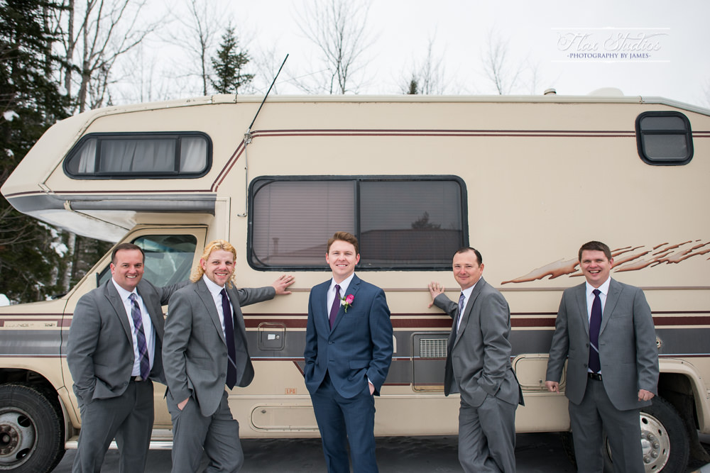 Funny bridal party photo with camper