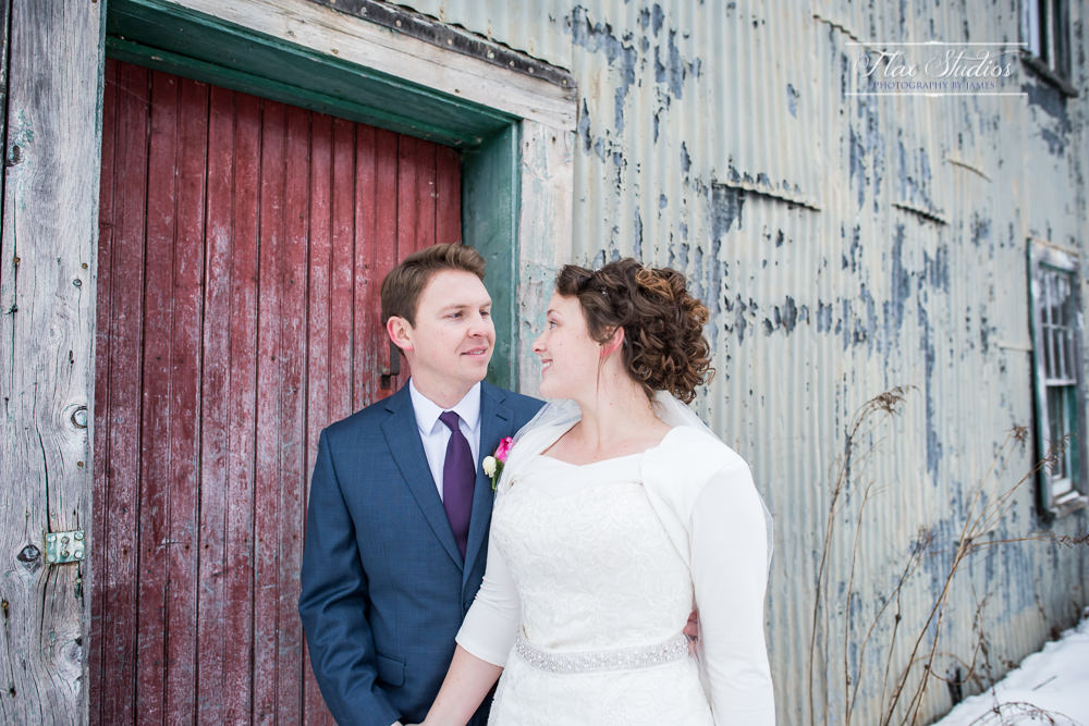 Bride and groom in front of an old building