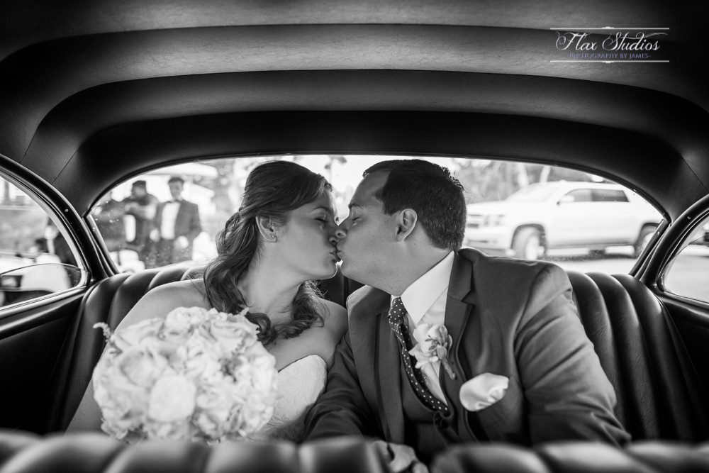 kissing in the back seat of a hot rod