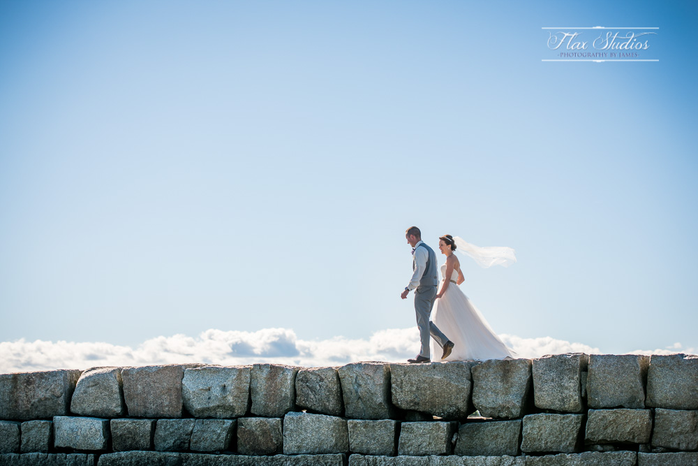 After the first look, we darted down the road quickly to the Breakwater at Kennebunkport beach for some breathtaking views! I'm so glad we rushed down there for a few shots right before the ceremony. Just look at the wind blowing the veil!