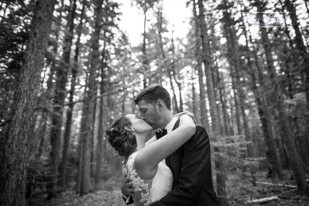 black and white wedding photos in the woods