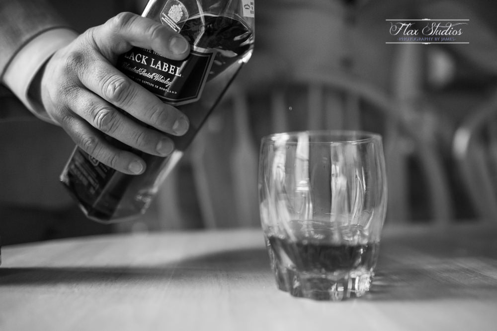johnnie walker black label pouring
