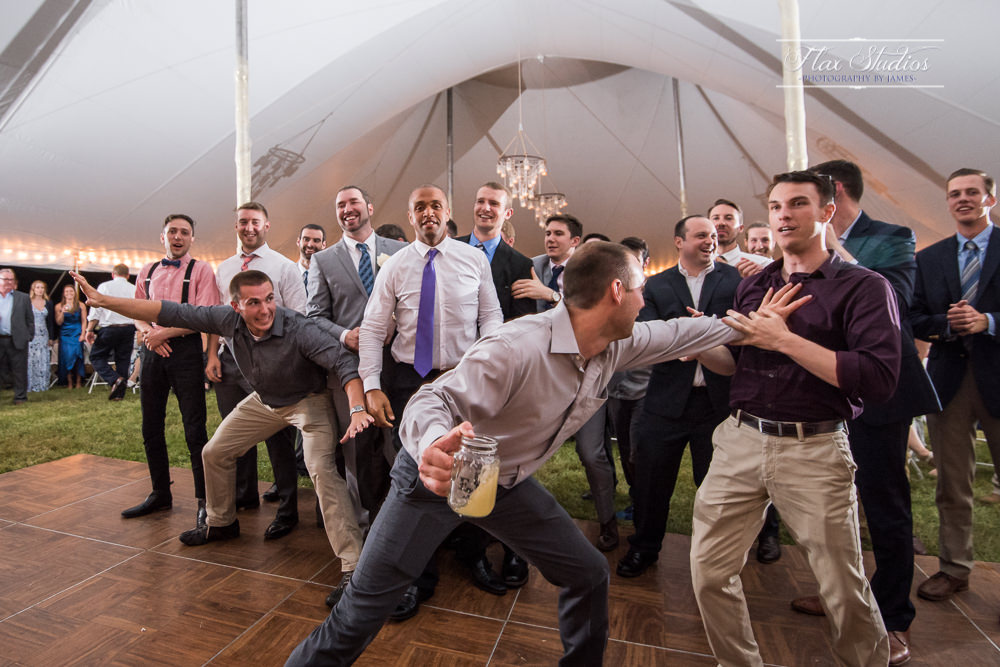 guys fighting over the garter toss