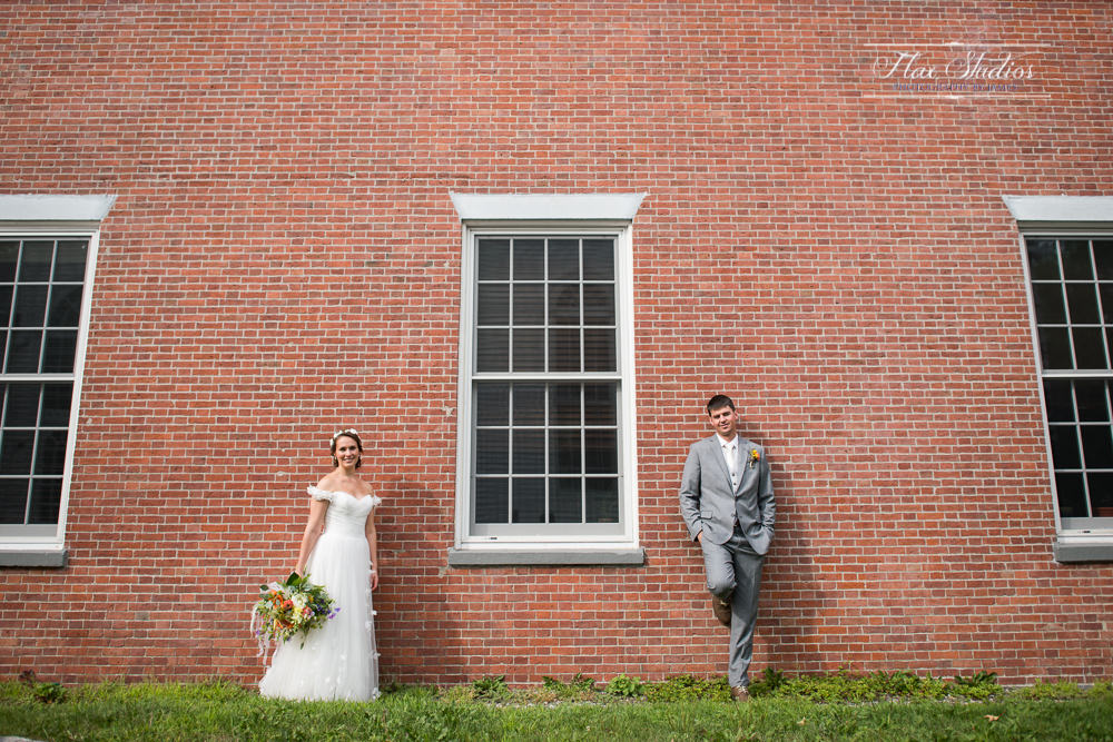 Using a brick wall for wedding photos flax studios