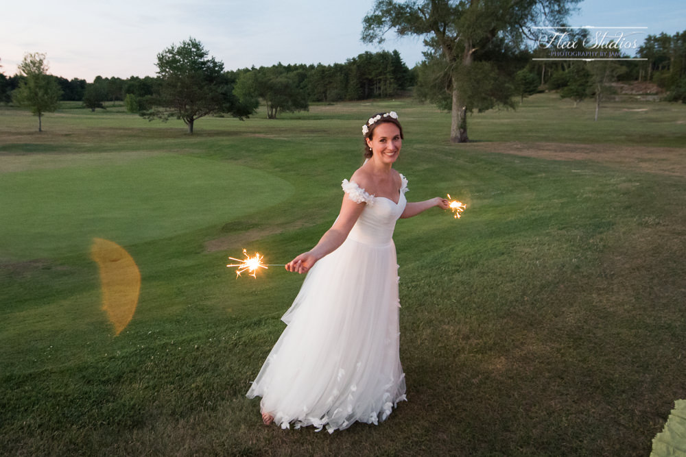 Bride running around with sparklers