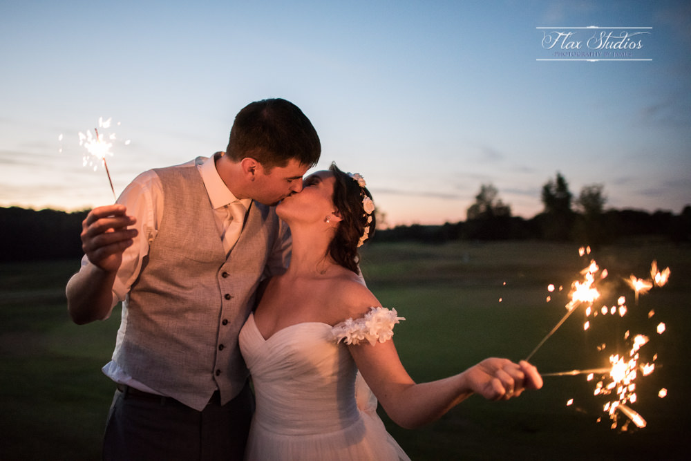 Bride and groom photo with sparklers