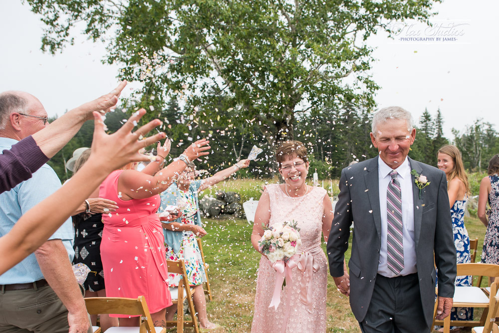 throwing confetti at the end of a wedding ceremony