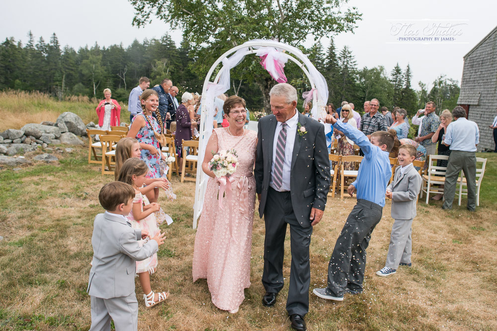 children throwing confetti at a wedding