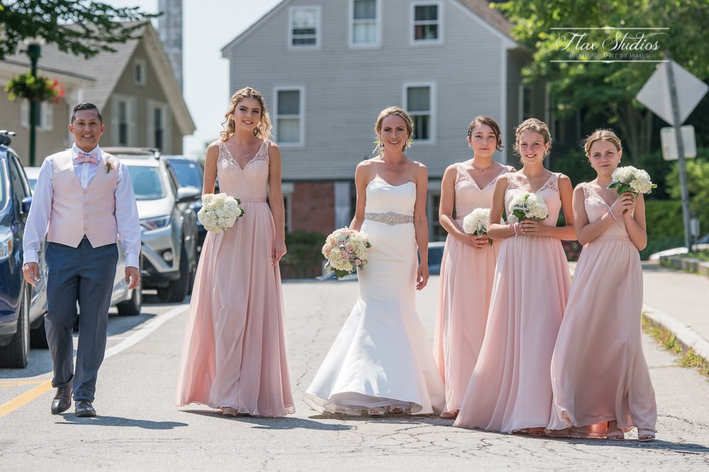 Bride walking down the road with bridesmaids