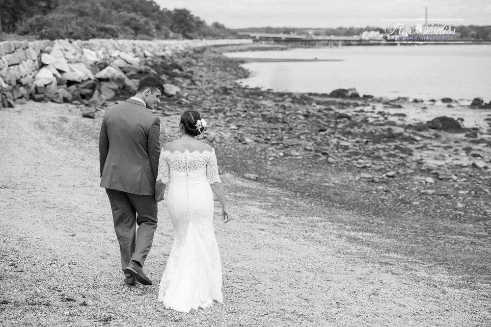Bride and Groom walking on the beach together