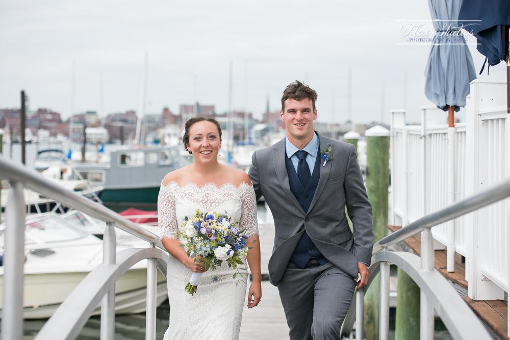 Bride and groom on a dock wedding photos