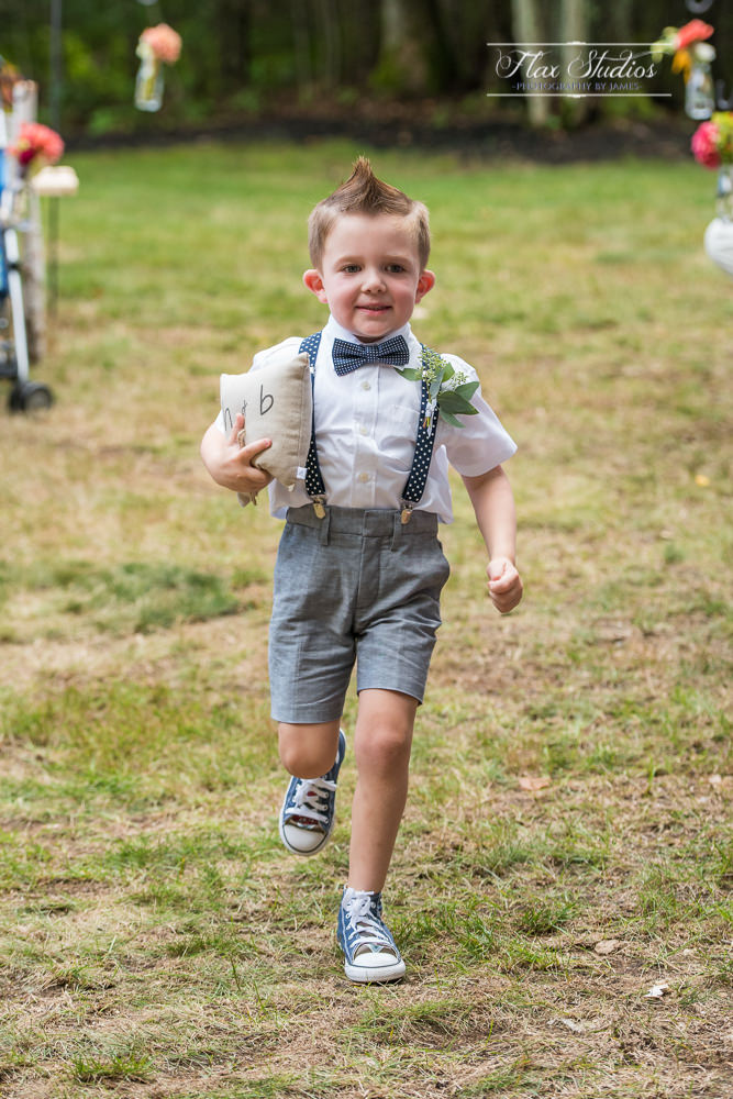 ring bearer running down the aisle