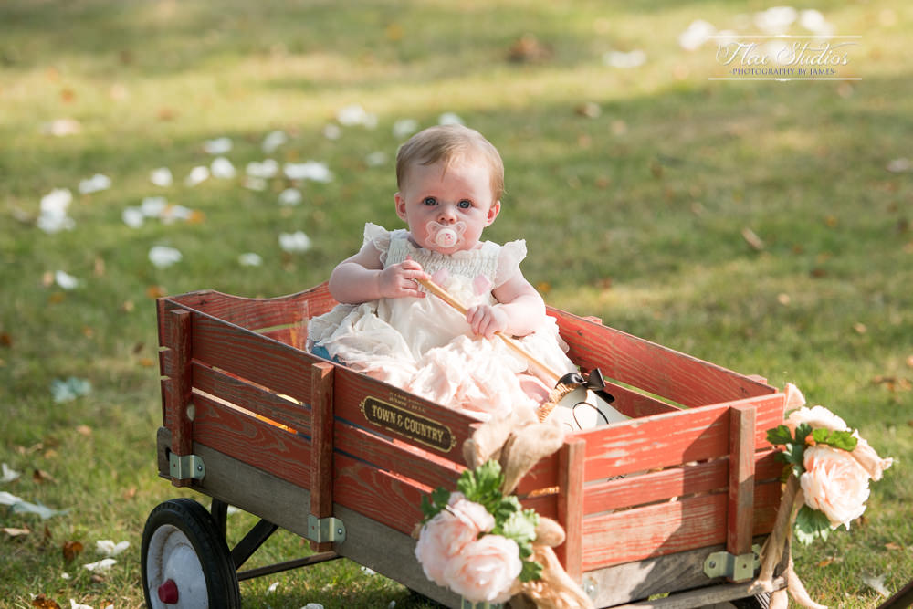 baby in a wagon being pulled down the aisle