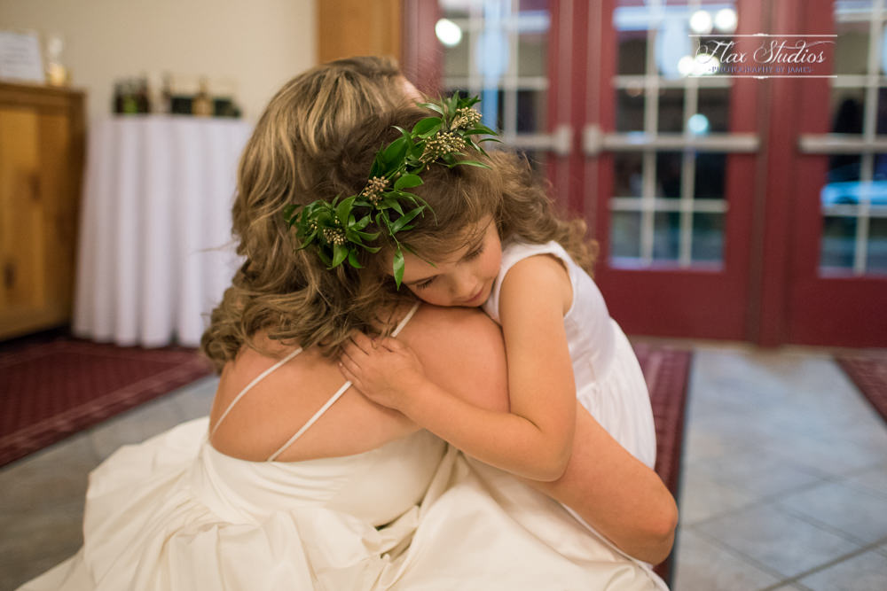 intimate moment between the bride and the flower girl