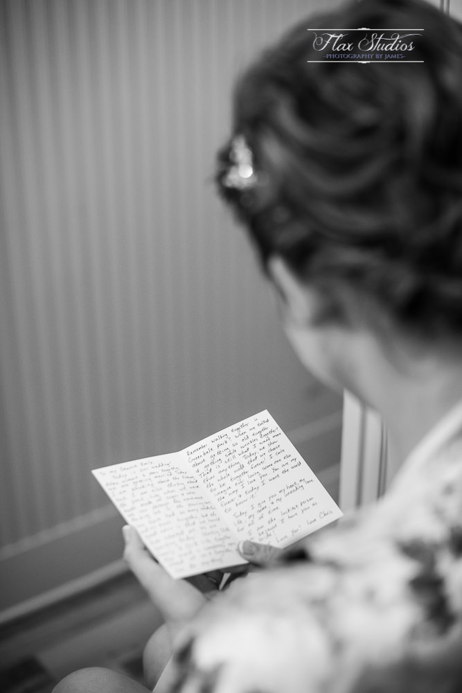 bride reading a wedding note from her groom