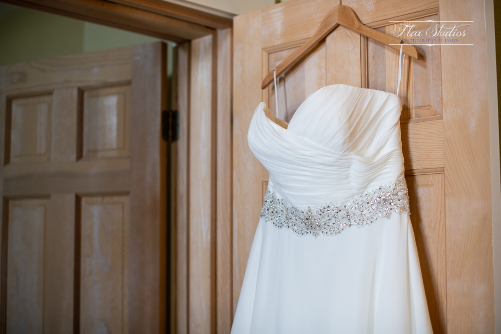 brides wedding dress hanging