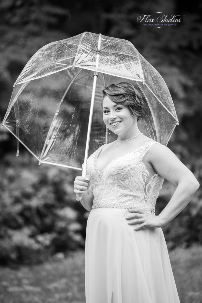 black and white bridal portraits in the rain