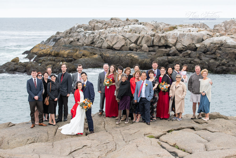 Large group wedding photo on the Maine oceanfront