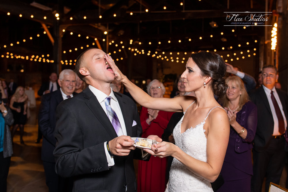 smashing cake in the grooms face