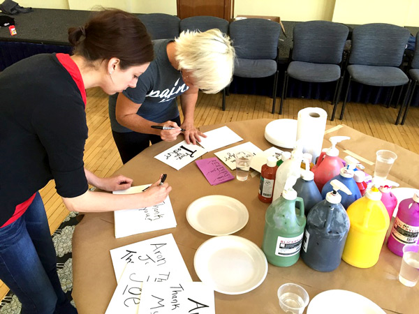 Paint Love Artists Caitlin Chase and Kim Warner working at the Thank You table!