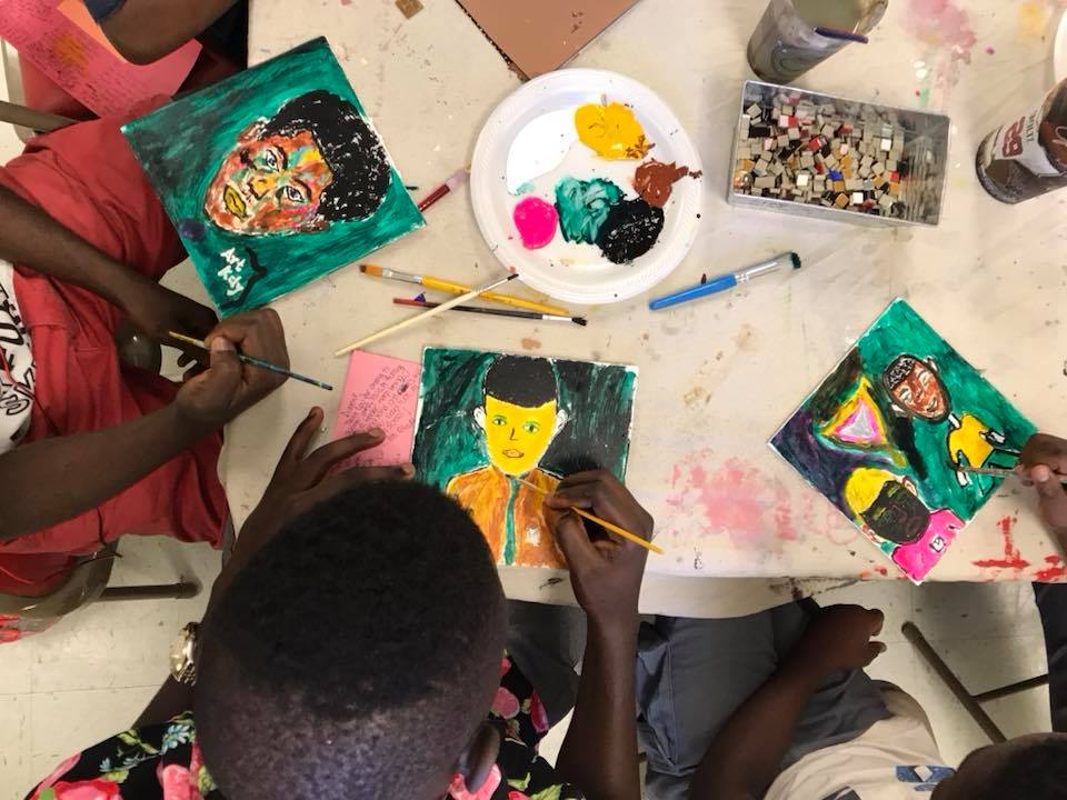 Paint Love art project mosaic tiles at New American Pathways
